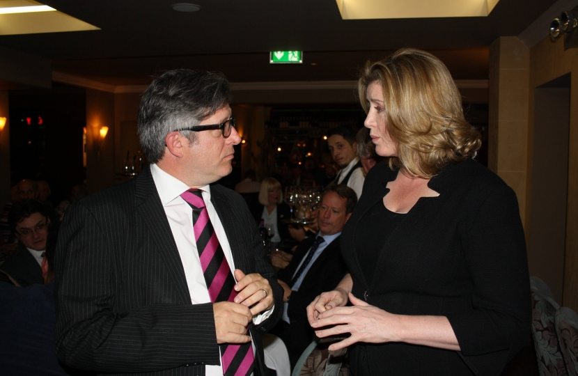 Mark Brooks OBE pictured above with the Rt Hon Penny Mordaunt MP Secretary of State for International Development at a function in Stuzzichini Restaurant, Bexleyheath