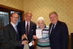 Association Chairman, Simon Windle, and David Evennett MP celebrate with Bernard and Edna Clewes.
