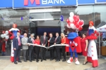 David Evennett MP pictured cutting the ribbon to open the branch.